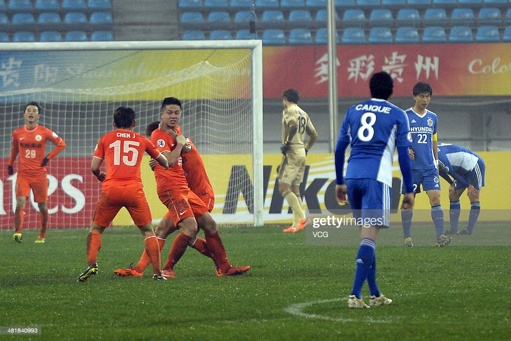 Chen Zijie #39 of Guizhou Renhe celebrates with team mates after scoring his team's third goal during the AFC Asian Champions League match between Guizhou Renhe and Ulsan Hyundai at Guiyang Olympic Centre on April 1, 2014 in Guiyang, China.