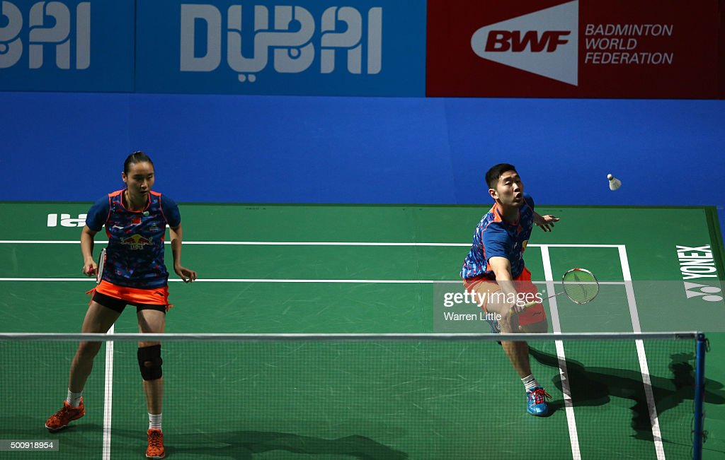 Cheng Liu and Yixin Bao of China in action against Sung Hyun Ko and Ha Na Kim of Korea in the Mixed Doubles match during day three of the BWF Dubai World Superseries 2015 Finals at the Hamdan Sports Complex on December 11, 2015 in Dubai, United Arab Emirates.