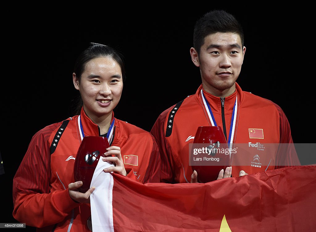 Cheng Liu and Yixin Bao of China on the podium receiving their bronze medal in the mixed double the Li-Ning BWF World Badminton Championships at Ballerup Super Arena on August 31, 2014 in Copenhagen, Denmark.