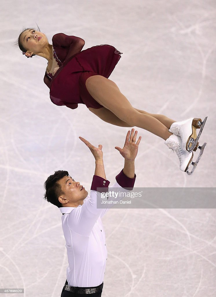 Cheng Peng and Hao Zhang compete in the Pairs Free Skating during the 2014 Hilton HHonors Skate America competition at the Sears Centre Arena on October 26, 2014 in Hoffman Estates, Illinois.