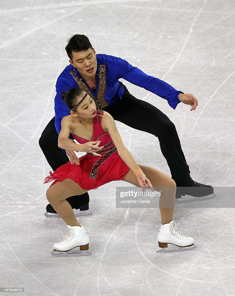 Cheng Peng and Hao Zhang compete in the Pairs Short Program during the 2014 Hilton HHonors Skate America competition at the Sears Centre Arena on October 25, 2014 in Hoffman Estates, Illinois.