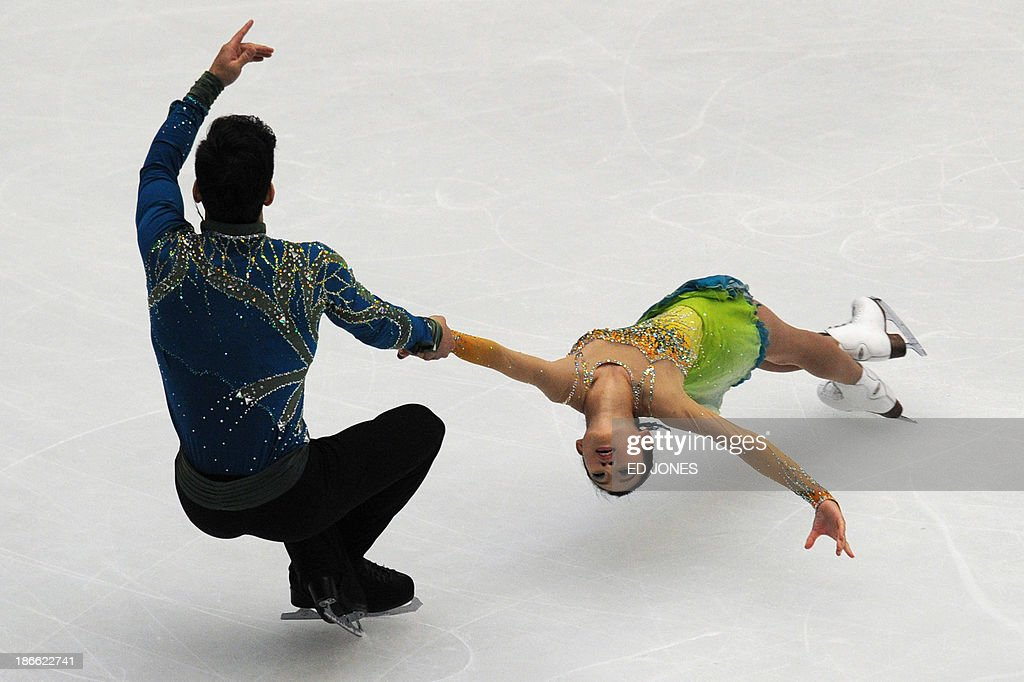 Cheng Peng and Hao Zhang of China compete during the Pairs Free Skating event of the Cup of China ISU Grand Prix Figure Skating in Beijing on November 2, 2013. Peng and Zhang finished with a score of 187.19 for third place. AFP PHOTO/ED JONES