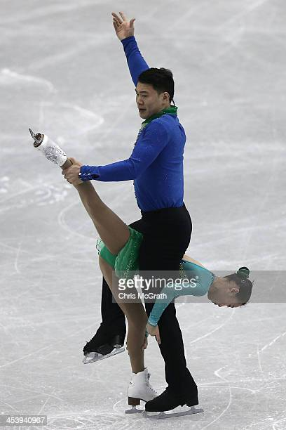 Cheng Peng and Hao Zhang of China compete in the Pairs Short Program during day two of the ISU Grand Prix of Figure Skating Final 2013/2014 at Marine...