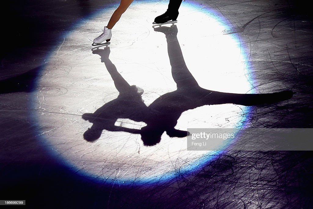 Cheng Peng and Hao Zhang of China perform during Lexus Cup of China ISU Grand Prix of Figure Skating 2013 at Beijing Capital Gymnasium on November 3, 2013 in Beijing, China.