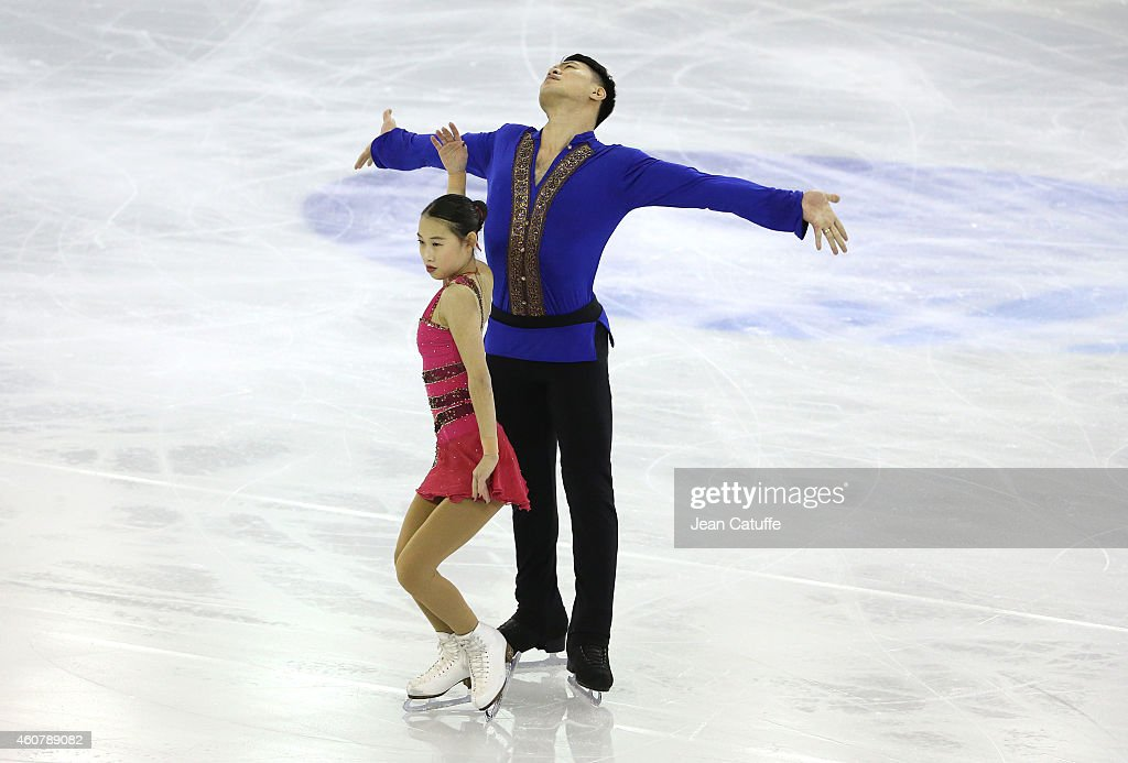 Cheng Peng and Hao Zhang of China perform during the Pairs Short Program final on day one of the ISU Grand Prix of Figure Skating Final 2014/2015 at Barcelona International Convention Centre on December 11, 2014 in Barcelona, Spain.