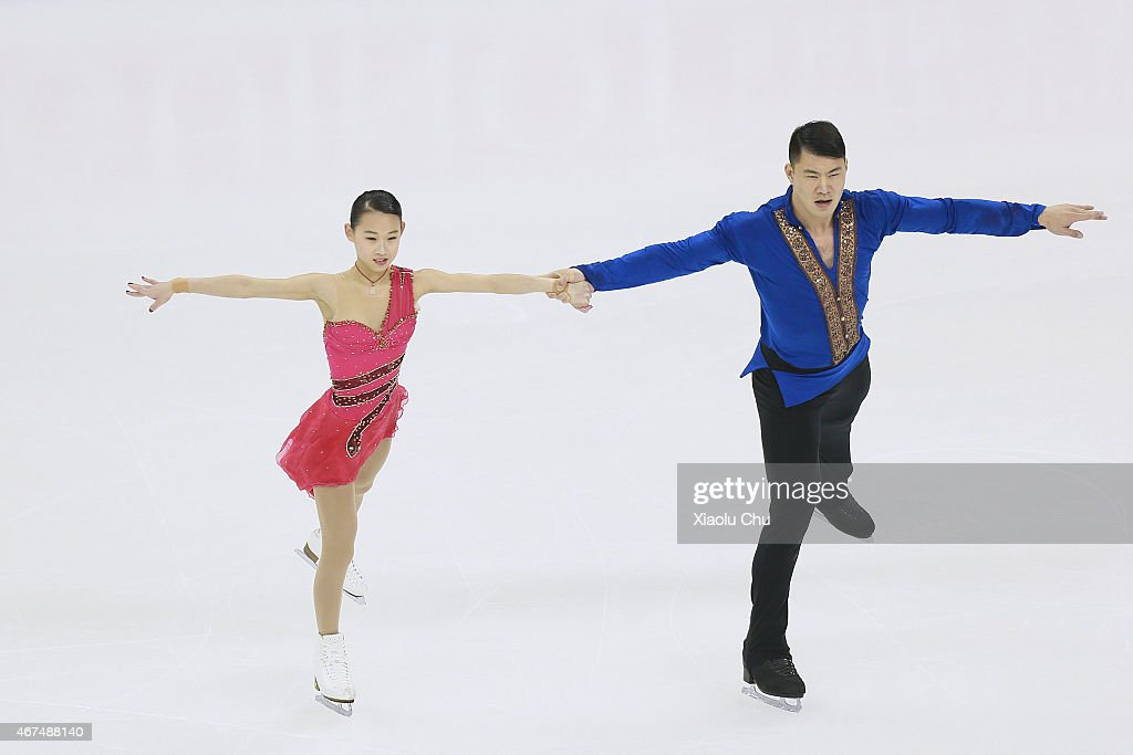 Cheng Peng and Hao Zhang of China perform during the Pairs Short Program on day one of the 2015 ISU World Figure Skating Championships at Shanghai Oriental Sports Center on March 25, 2015 in Shanghai, China.