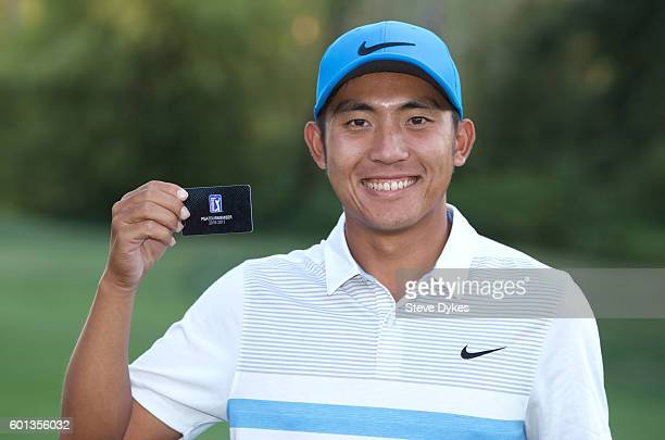 Cheng Tsung Pan of Taiwan holds up his PGA tour card after the final round of the WinCo Foods Portland Open on August 28 2016 in North Plains Oregon