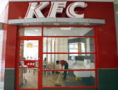 An employee sweeps the floor at the US fastfood Kentucky Fried Chicken restaurant in Chengdu in China's southwestern province of Sichuan 26 October...