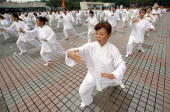 Hundreds of devotees of Taoism perform tai chi chuan at the closing ceremony of the Second China Taoism Culture Festival in Chengdu China's...
