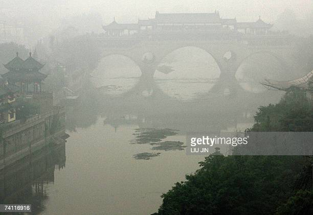 Overview of a bridge covered in a heavy haze caused by tons of dry stalks burning on the outskirts of Chengdu in southwest China's Sichuan province...