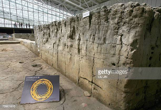 Visitors admire the excavation site of the Sun and Bird gold foil at the newly opened Jinsha Museum in Chengdu southwest China's Sichuan province 16...