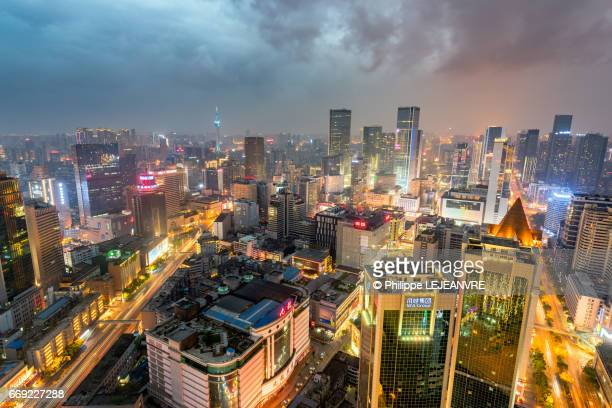 Chengdu city skyline aerial view at dusk with dark clouds