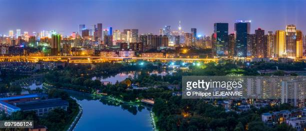 Chengdu city skyline panorama at night with a river in the foreg