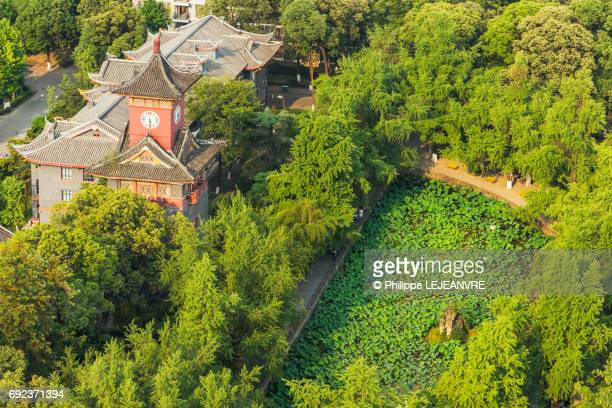 Chengdu clock tower and pond among trees aerial view
