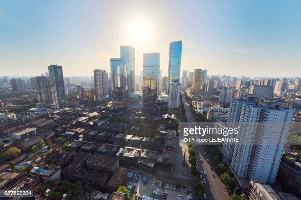 Chengdu downtown skyscrapers against sun aerial view