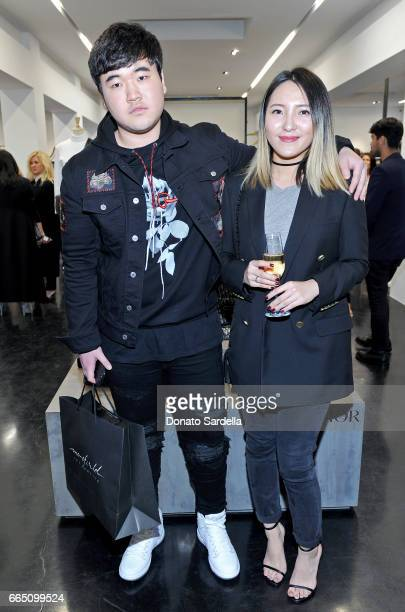 Chenghao Yin and guest attend DIOR SS17 Collection Launch at Maxfield on April 5 2017 in Los Angeles California