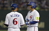 ChengMin Peng of Chinese Taipei talks with coach WeiCheng Chen after hits a RBI single in the fifth inning during the World Baseball Classic Second...