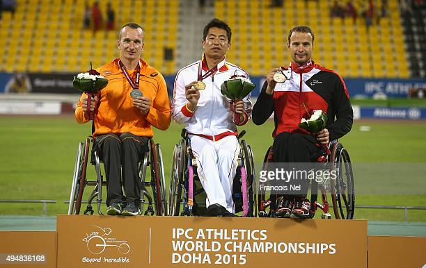 Chengming Liu of China poses with his gold medal Kenny van Weeghel of the Netherlands silver and Marcel Hug of Switzerland bronze for the men's 800m...