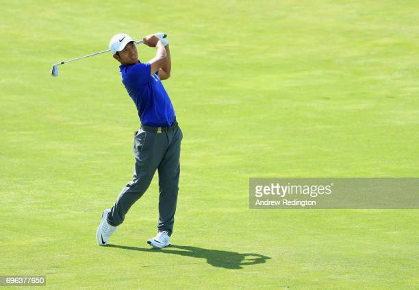 ChengTsung Pan of Chinese Taipei plays his shot on the 17th hole during the first round of the 2017 US Open at Erin Hills on June 15 2017 in Hartford...