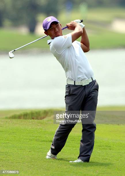 ChengTsung Pan of Taiwan watches his 2nd shot on the 18th hole during Day Two of The Open Qualifying Series Thailand 2014 at the Amata Spring Golf...