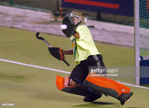 Indian field hockey goalkeepr Bharat Chetri stops an attempt to goal during a Champions Trophy match in Chennai 14 December 2005 Germany beat india...