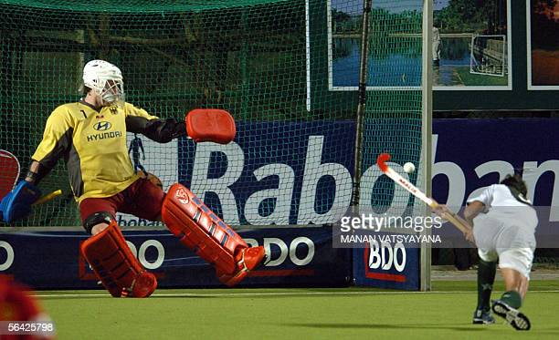 Pakistan field hockey player Mohammad Saqlain flicks tha ball past German goalkeeper Christian Schulte to score the equalising goal from a penalty...
