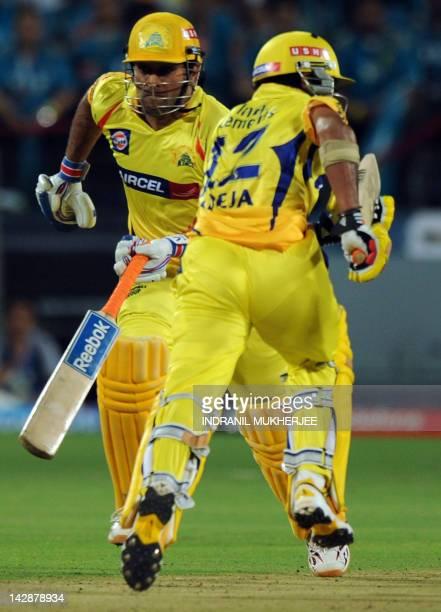 Chennai Super Kings batsmen Mahendra Singh Dhoni and Ravindra Jadeja take a run during the IPL Twenty20 cricket match between Pune Warriors India and...