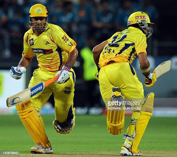 Chennai Super Kings batsmen Mahendra Singh Dhoni and Ravindra Jadeja takes a run during the IPL Twenty20 cricket match between Pune Warriors India...