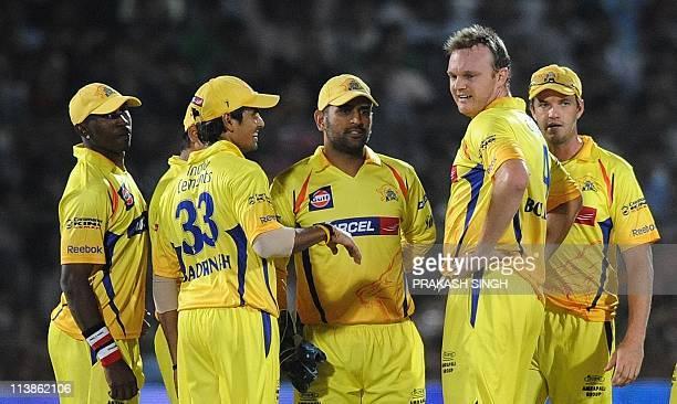 Chennai Super Kings Bowler Doug Bollinger celebrates the wicket of Rajasthan Royals batsman Rahul Dravid with teammates during the IPL Twenty20 match...