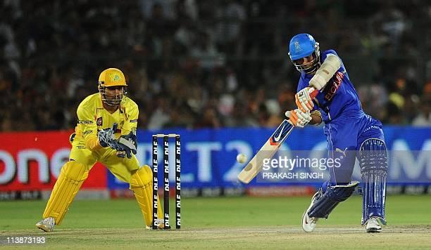 Chennai Super Kings bowler wicket keeper captain Mahendra Singh Dhoni watches as Rajasthan Royals bataman Ajinkya Rahane plays a shot during the IPL...