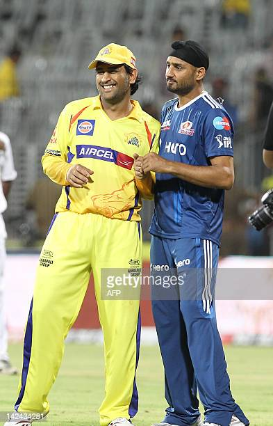 Chennai Super Kings captain and wicket keeper Mahendra Singh Dhoni stands next to Mumbai Indians captain Harbhajan Singh during the IPL Twenty20...