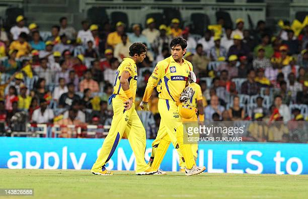 Chennai Super Kings' captain MS Dhoni walk with Ravindra Jadeja after defeating Deccan Charges by 10 Runs during the IPL Twenty20 cricket match...