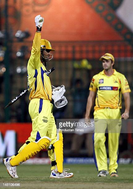 Chennai Super Kings captain Mahendra Singh Dhoni celebrating after his teams' victory in the first eliminator match of IPL 5 played btween Mumbai...