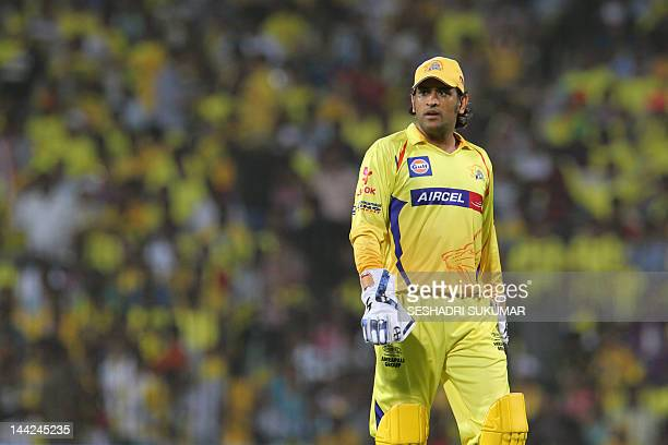 Chennai Super Kings captain Mahendra Singh Dhoni looks on during a changeover during the IPL Twenty20 cricket match between Chennai Super Kings and...