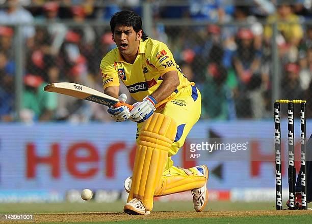 Chennai Super Kings captain Mahendra Singh Dhoni plays a shot during the IPL Twenty20 cricket match between Mumbai Indians and Chennai Super Kings at...