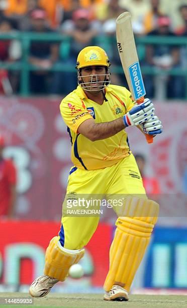 Chennai Super Kings captain Mahindra Singh Dhoni plays a shot during the IPL Twenty20 cricket match between Kings XI Punjab and Chennai Super Kings...