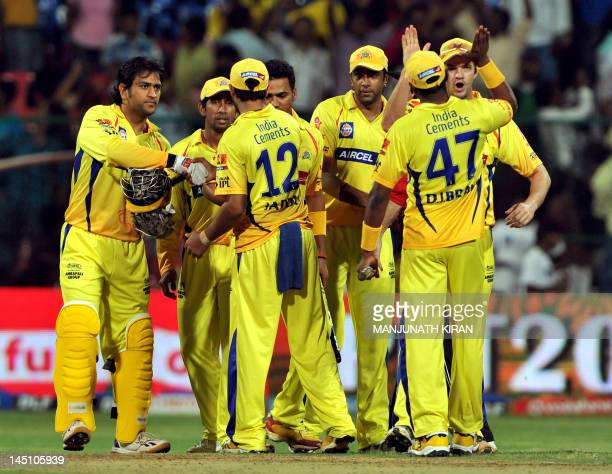 Chennai Super Kings captain MS Dhoni and his teammates celebrate their victory against Mumbai Indians during the IPL Twenty20 cricket 2nd Playoff...