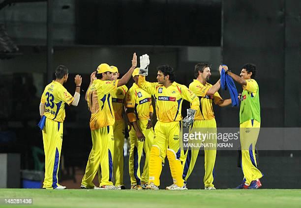 Chennai Super Kings teammates celebrate the catch dismissal of Delhi Daredevils batsman David Warner during the IPL Twenty20 cricket 2nd Qualifier...