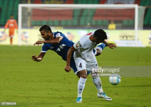 Chennaiyin FC Bikramjit Singh vies for the ball with NorthEast United FC Nirmal Chettri during the Indian Super League football league match between...