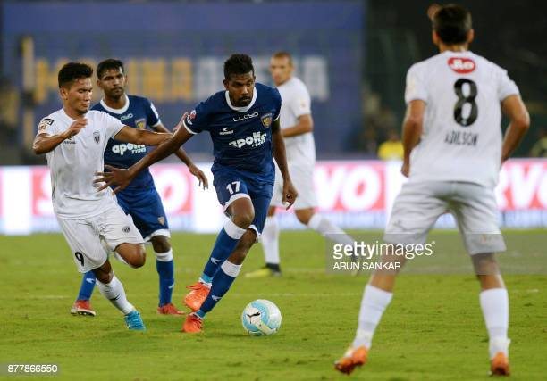Chennaiyin FC Dhanapal Ganesh vies for the ball with NorthEast United FC Seiminlen Doungel during the Indian Super League football league match...