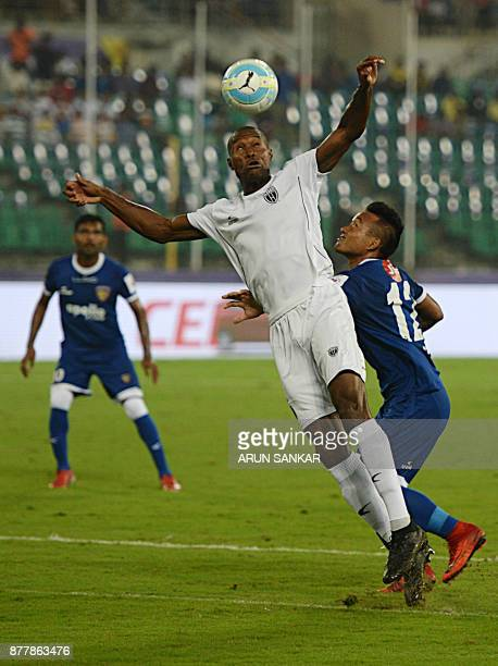 Chennaiyin FC Jeje Lalpekhlua vies for the ball with NorthEast United FC Jose Julio Gomes Goncalves during the Indian Super League football league...