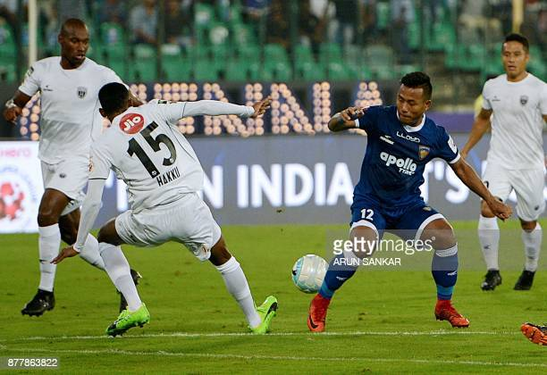 Chennaiyin FC Jeje Lalpekhlua vies for the ball with NorthEast United FC's Abdul Hakku during the Indian Super League football league match between...