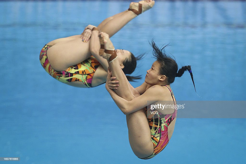 <a gi-track='captionPersonalityLinkClicked' href=/galleries/search?phrase=Cheong+Jun+Hoong&family=editorial&specificpeople=795329 ng-click='$event.stopPropagation()'>Cheong Jun Hoong</a> and Ng Yan Yee of Malaysia compete in the Women's 3m Springboard Synchro Final during day one of the FINA Diving World Series Beijing Station at the National Aquatics Center on March 15, 2013 in Beijing, China.
