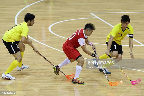 Cheong Zhi Xian Brandon of Singapore tries to get past the Malaysian defence during the World University Championship Floorball match between...