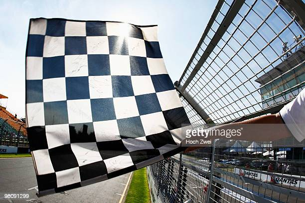 Chequered flag is waved by a marshall during practice for the Australian Formula One Grand Prix at the Albert Park Circuit on March 26 2010 in...