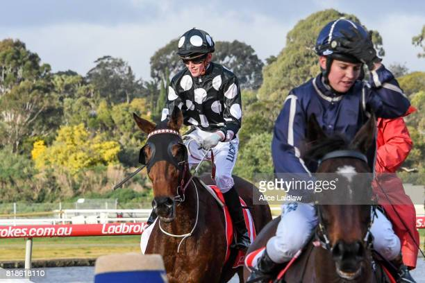 Chequered Flag ridden by Ben Allen returns to scale after winning the Chef's Hat Handicap at Ladbrokes Park Hillside Racecourse on July 19 2017 in...