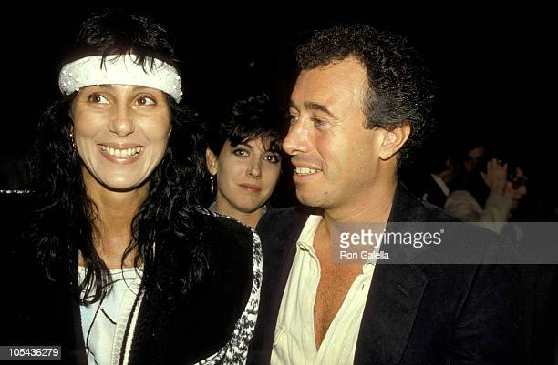 Cher and David Geffen during 'The Year of Living Dangerously' Los Angeles Screening January 26 1983 at MGM Commissary in Culver City California...