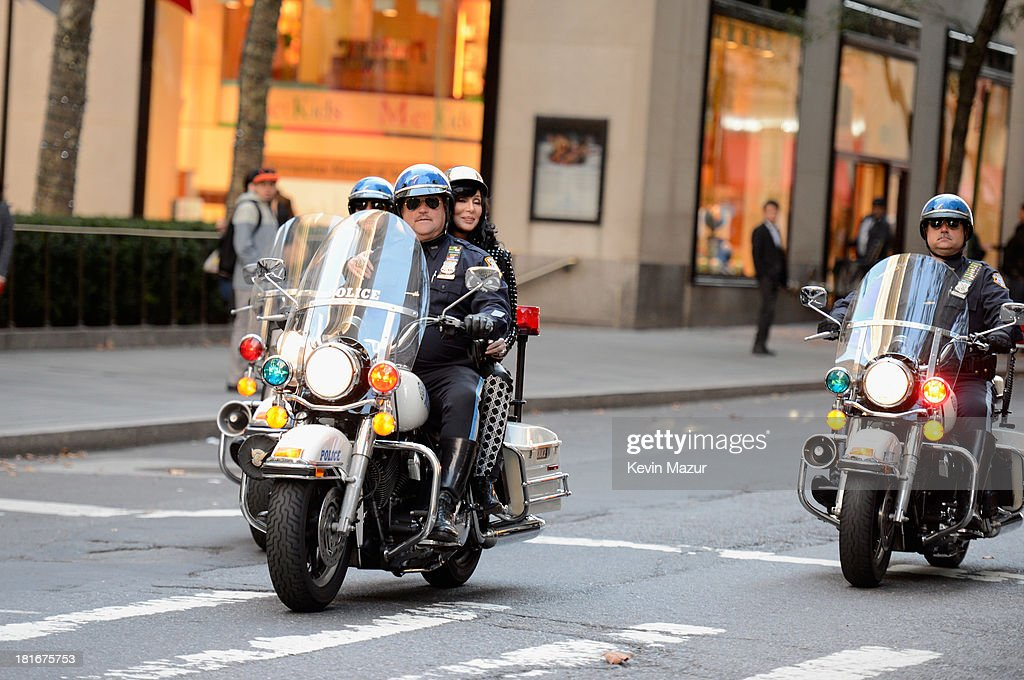 Cher arrives via police escort to perform on NBC's 'Today' at Rockefeller Plaza on September 23, 2013 in New York City.