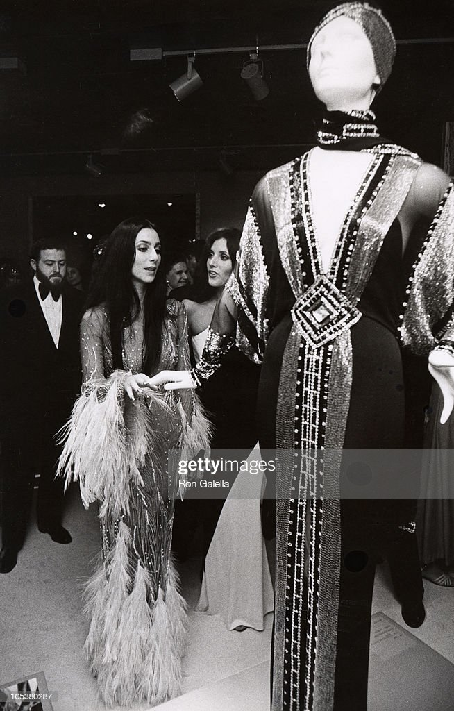 """Cher - Romantic and Glamorous Hollywood :This is one of my all time favorite photos of Cher. The backlight behind her head created an angelic feel. Cher attended the event with her designer, Bob Mackie, who managed to fill in all the right places with this spectacular feather and sequined gown. Cher became friendly with my style and invited me to her Beverly Hills home for an exclusive photo shoot. The photos ran worldwide."" - Ron Galella 