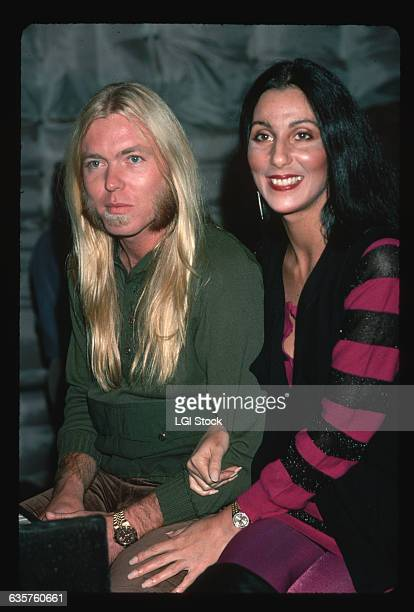 Cher holds onto the arm of husband Gregg Allman singer and keyboardist for the Allman Brothers